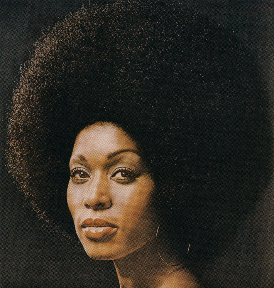 Bust portrait of a black woman looking at the camera by Hank Willis Thomas
