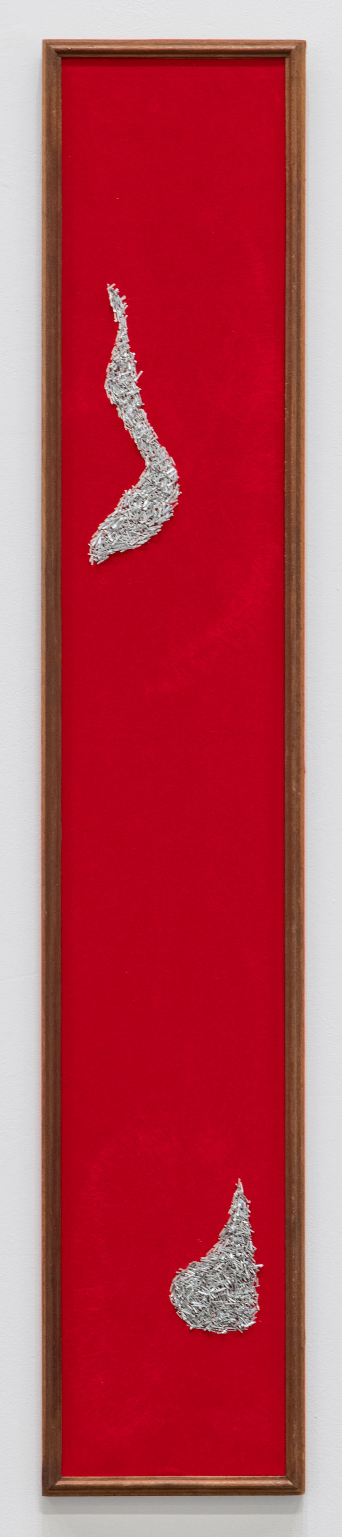 Vertical red panel with foil shapes at the top and bottom