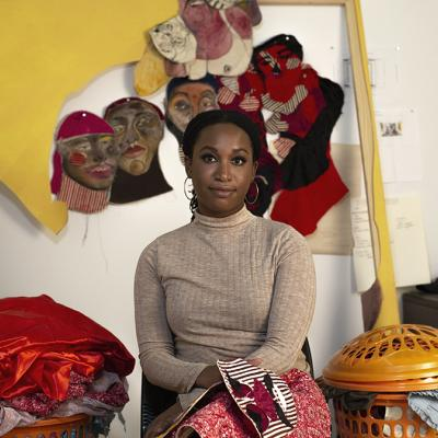 Tschabalala Self sits in their studio.